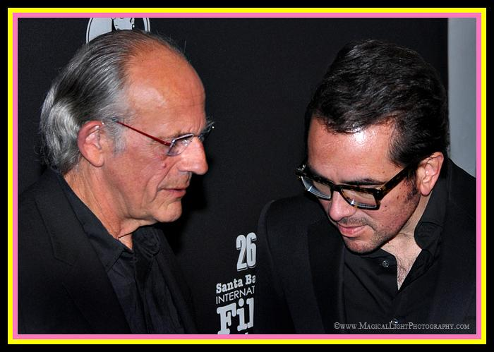 "SBIFF Regular, Christopher Lloyd and Roger Durling are deep in thought on the red carpet.<br />For you trivia buffs, Roger had just asked Lloyd, ""What does a yellow light mean?"""