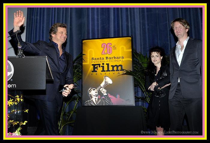 "2011 SBIFF<br />Ensemble Award Recipients<br />""The King's Speech""<br />After being presented the ""Best Ensemble Cast"" award by director Tom Hooper (stage right,) best Actor nominee Colin Firth bids adieu to the cheering audience.Fellow ""Ensemble"" recipient Helena Bonham-Carter looks on as well."