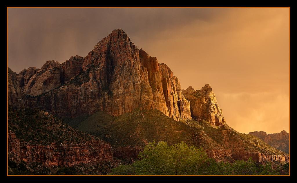 Sunset light gives way to storm clouds over the iconic Watchman.<br />By Marie Taylor-Cagara<br />Zion National Park, Utah.  USA         April 2014