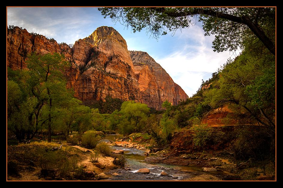 Morning sunlight begins to bathe red rock and Spring green.<br />Zion National Park, Utah.- April  2014