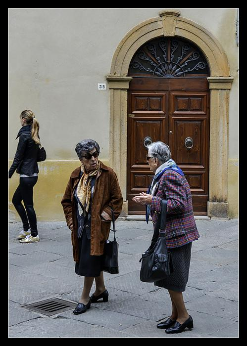 These properly dressed matrons contrast markedly with their younger, hip contemporary.Pienza, Tuscany.