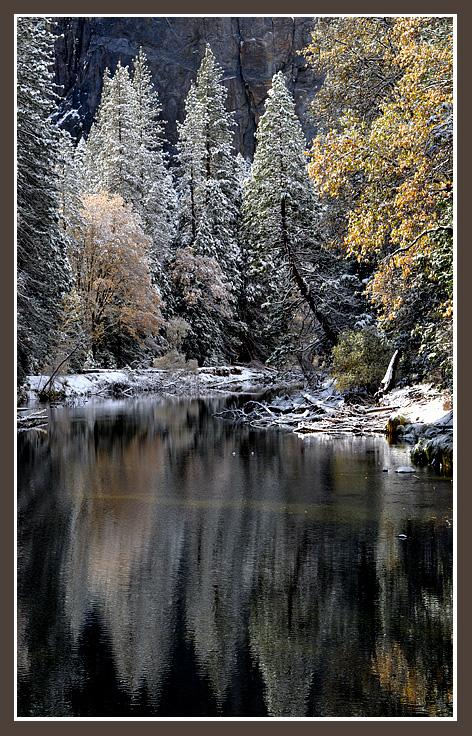 November 10, 2012An early season snow makes for a magical morning scene in Yosemite as fall colors are muted by winter white along the Merced River.
