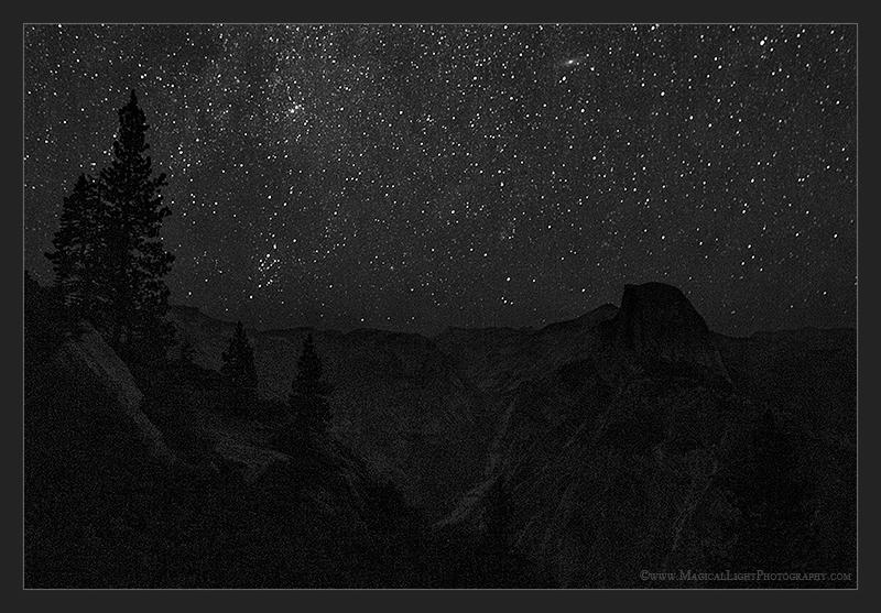 "The seen and the nearly unseen insinuate their hypnotic magic deep into the recesses of the mind and make as one all who have ever and all who would one day still gaze upward with wonder and awe into the firmament... Enjoy this view conceived on a warm August night of Messier Object M31 (The Andromeda Galaxy) standing watch over Yosemite's monolithic icon, Half Dome.M31 is very near the top of the scene in the 11 o'clock position above Half Dome's ""visor.""August 11, 2013"