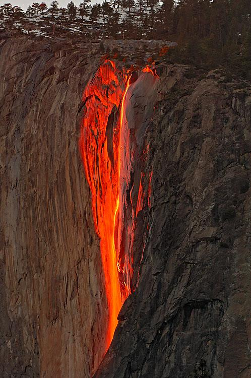 Horsetail Fall 'Fire Fall'  - No.2128<br />Warm red wavelength light near the western horizon casts a rich glow along the rock face of El Capitan and the wispy ephemera of Horsetail Fall.
