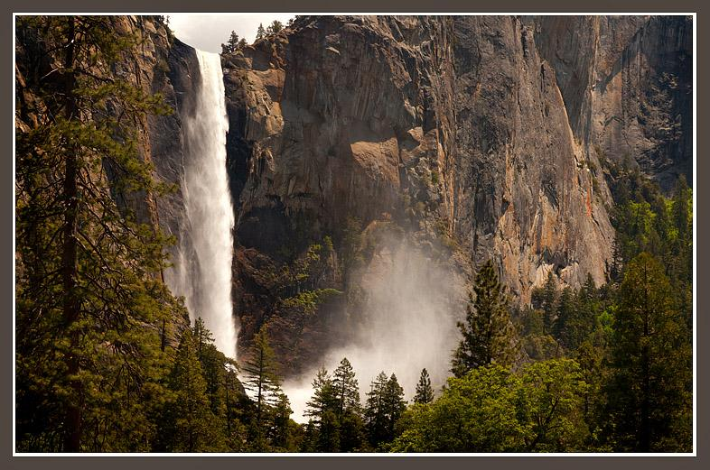 "This year's exceptional snow pack drives Yosemite's Bridalveil Fall with a vengeance where the force of the water dropping more than 600' into the precipice generates a wind that creates the misty ""bridal veil."""