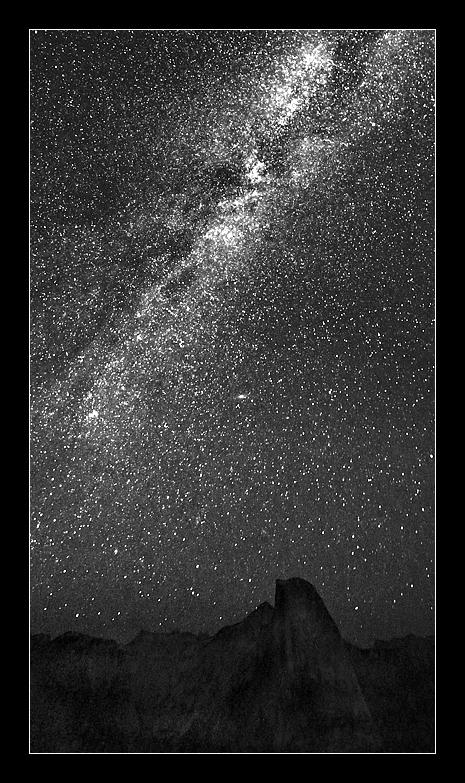 "The Milky Way Galaxy (Earth's celestial home base) is an impressive sight in its own right - but is made more so when viewed from the grandeur of a majestic location like Yosemite National Park on a dark Summer's night. The silence is deafening as you view, or rather 'absorb' the cosmos. Its dust and ""star stuff"" infuse your being. Literally. Please enjoy this partial view of the Milky Way (it makes an arc across the entire sky) as we rotate beneath and within it, passing this night over Yosemite's Half Dome, as it has done each and every night for the nearly 5 billion years of planet Earth's existence. Note, also, that M31, better known as the ""Andromeda Galaxy"" is visible in the middle of the scene at the 11 o'clock position over Half Dome's ""visor."" August 10, 2013"