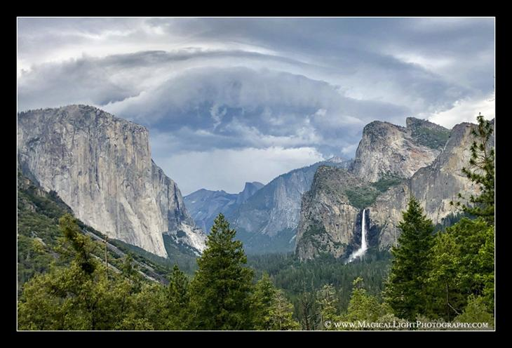 Storm clouds in the high country converge over Half Dome.<br />June 2019