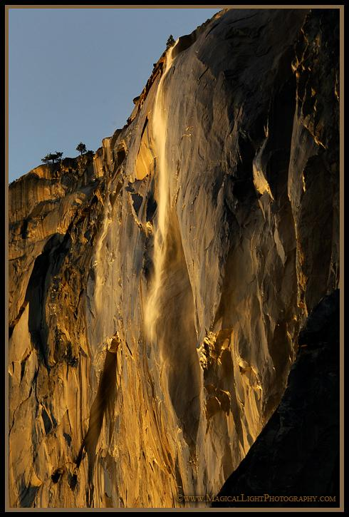 A break in clouds to the west allows for rich, golden sunlight to wash over the rock face of El Capitan and Horsetail Fall some twenty minutes before sunset.Alas, by sunset the clouds had returned and the scene turned a dreary, dull grey.