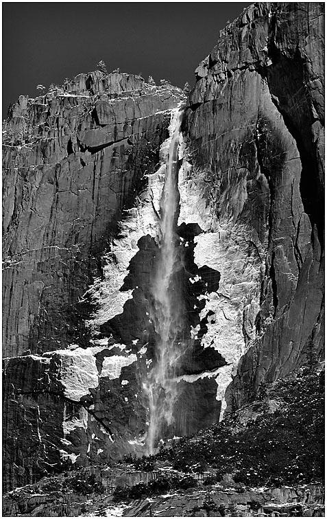 "Wind-blown mist freezes and adheres to the rock face on both sides of Upper Yosemite Falls, creating ever-changing ""Rorschach"" patterns.""Upper Falls,"" seen here, has a vertical drop of 1,430'.The full drop of all three sections of the falls is 2,425' making Yosemite Falls the tallest waterfall in North America and the sixth tallest in the World."