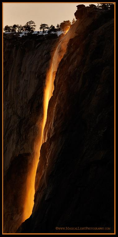 Warm sunlight bathes the wispy ephemera of Horsetail Fall in rich golden hues at sunset.