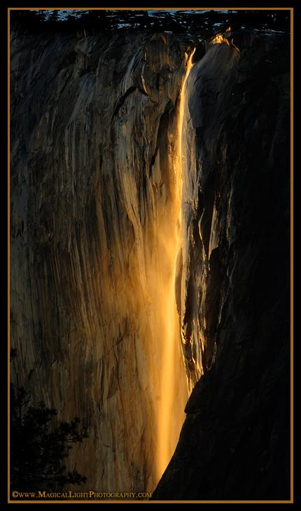 "A golden veil of mist is blown away from the rock face of El Capitan during the annual Horsetail Fall ""Fire Fall"" event."