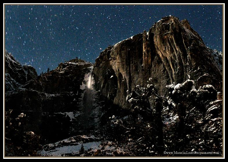 A break in the weather between snow storms allows soft, streaming moonbeams to caress the face of Upper Yosemite Falls in the dead of a cold winter's night.January 23, 2010; 11:54 pm; 21 degrees F.